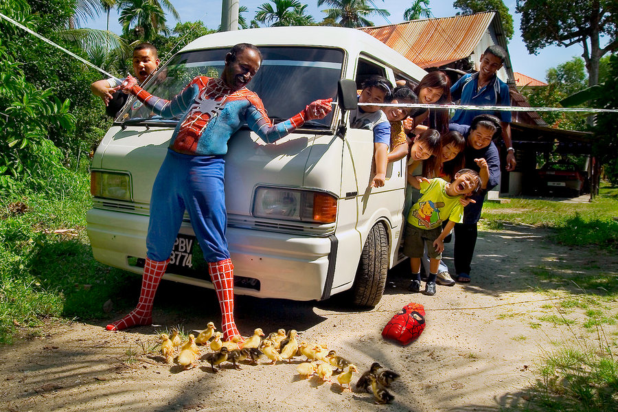 asian spiderman with kids van